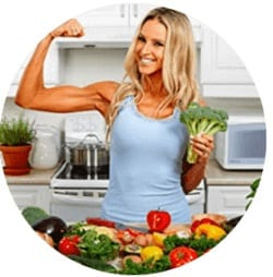 A Healthy Woman showing here bicep muscle from eating the high protein vegan diet