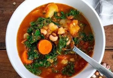1 month vegan challenge vegetable soup in a white bowl