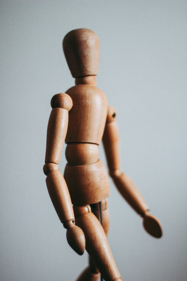 Wooden mannequin depicting bmi instead of human body