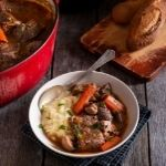Beef Bourguignon Recipe with the red crock pot and a white bowl