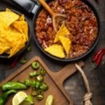 Chilli Con Carne recipe. Chilli con carne in a pan with tortilla chips on the side