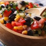 Black Bean with corn in a wooden bowl