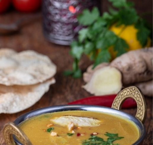 Mulligatawny Soup in a silver bowl